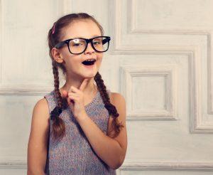 happy thinking little girl