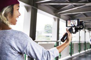 girl holding phone camera