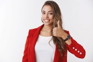 Girl assuring you have lucky day. Happy smiling gorgeous female entrepreneur showing thumb up, liking approving awesome idea delighted giving positive reply, agree, standing white background
