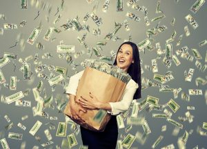 excited young woman with money