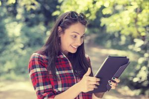 woman excited looking at touch pad pc
