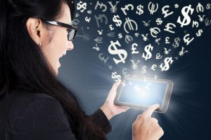 Businesswoman making money online with tablet