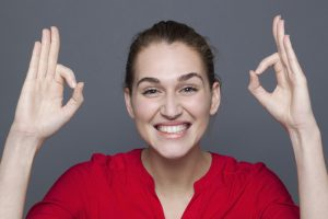 ecstatic young woman gesturing to express winning success