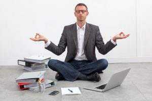 peaceful entrepreneur practicing yoga, seeking for inspiration
