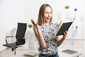 Excited female with notepad