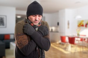 Portrait of sick man shivering from cold