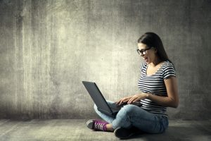 Woman Using Laptop, Happy Girl in Glasses on Notebook, Young Adu