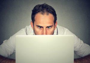 shocked man looking at screen