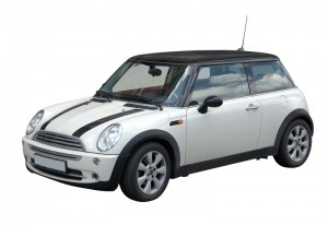 White mini car in retro style with black sport stripes isolated on white with clipping path